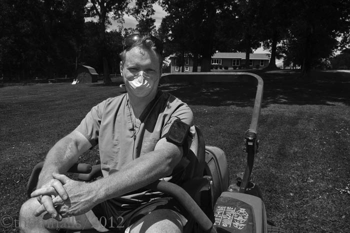 Brian Purser, rural North Carolina - Burser mows his 2 arce lawn, a Saturday afternoon ritual practiced by many in the rural south.