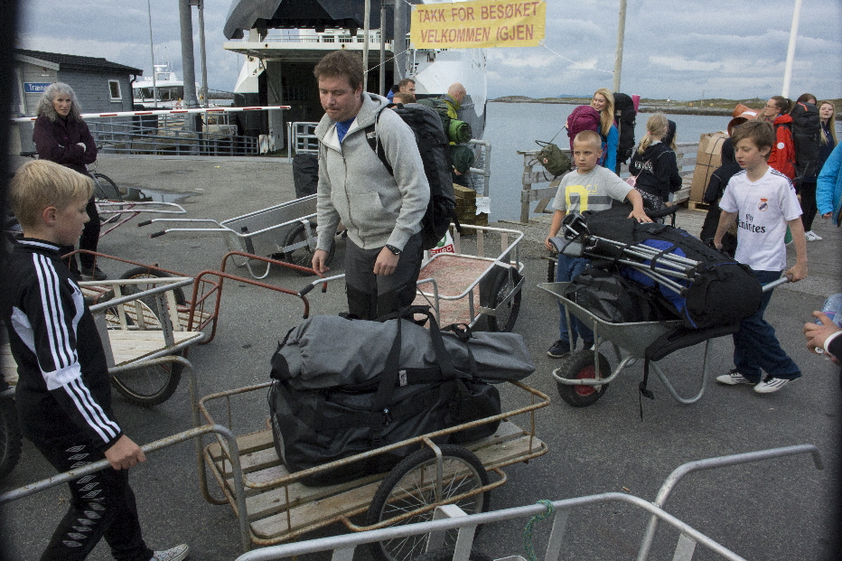 Early in the week the ferries arrive with people who have bought their tickets months in advance. The chiildren of the island make hundreds of dollars hauling luggage and camping equipment to the campgrounds on the west side of the island.