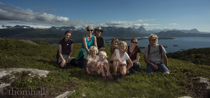 Members of our group pose on a high ridge facing the bays and glacier near Engvaagon.